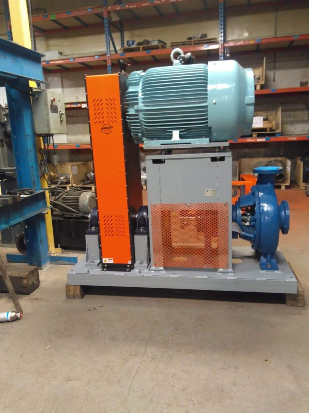 Vertical Belt Guard installed on a pump package that was shipped to a mine in Northern Canada.